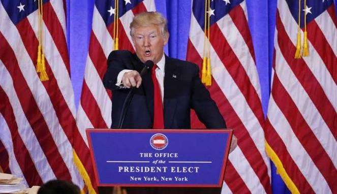 587701a58a3b1-presiden-terpilih-as-donald-trump-saat-konferensi-pers-dengan-wartawan_663_382
